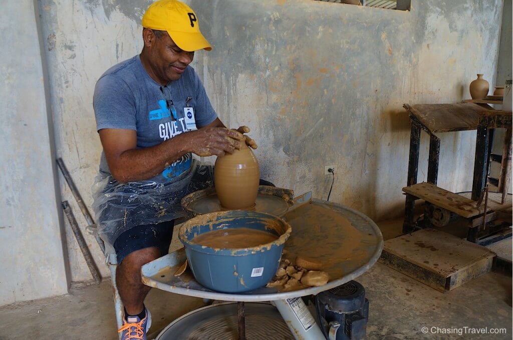 making a clay water filter in dominican republic with wine to water