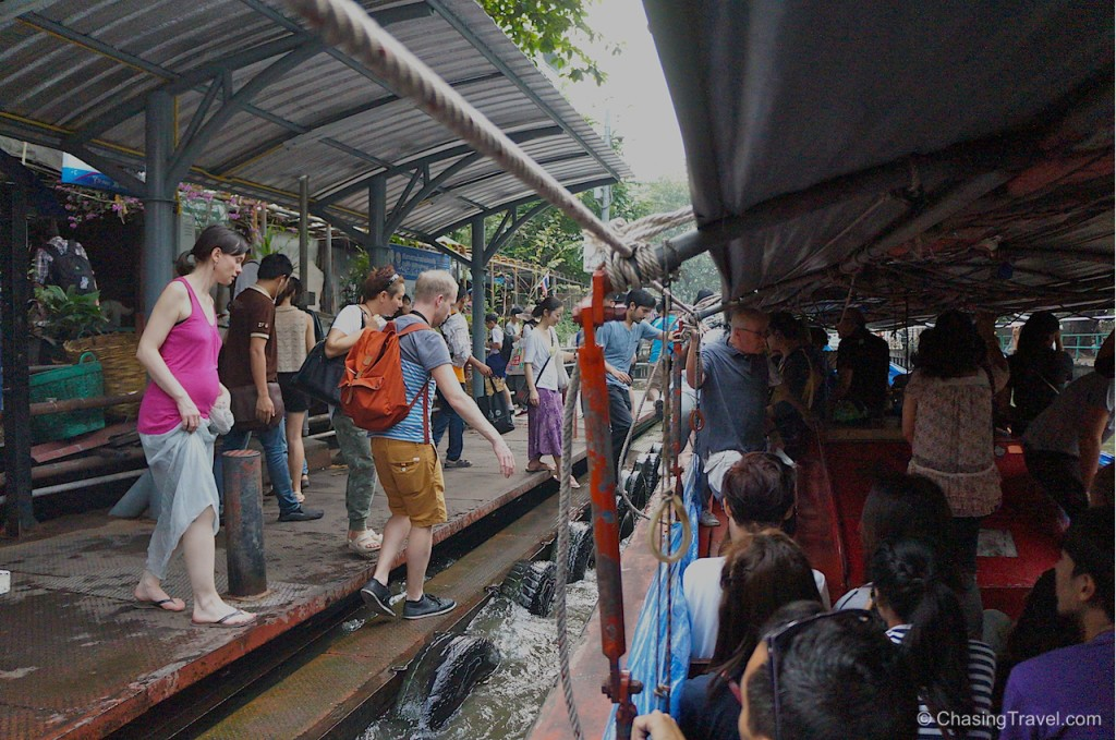getting on a boat taxi klong bangkok